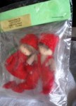dollhouse dolls in red in pkg